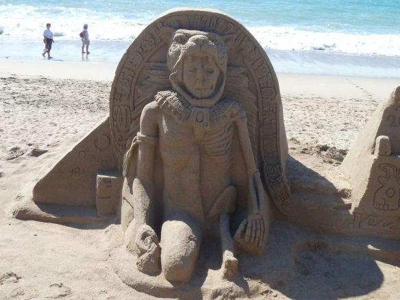 Mayan man skeleton sand sculpture.
