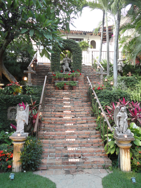 Old rustic stairway to the guest suites.