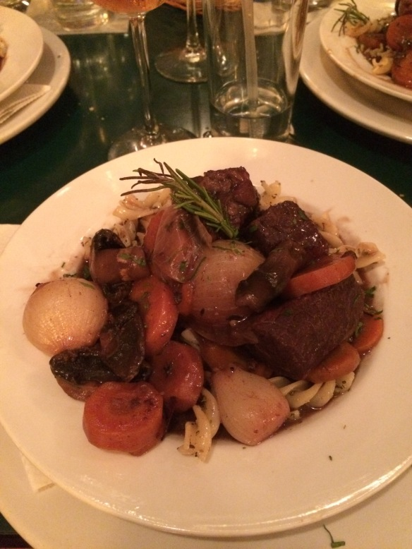 Beef bourguignon over pasta.