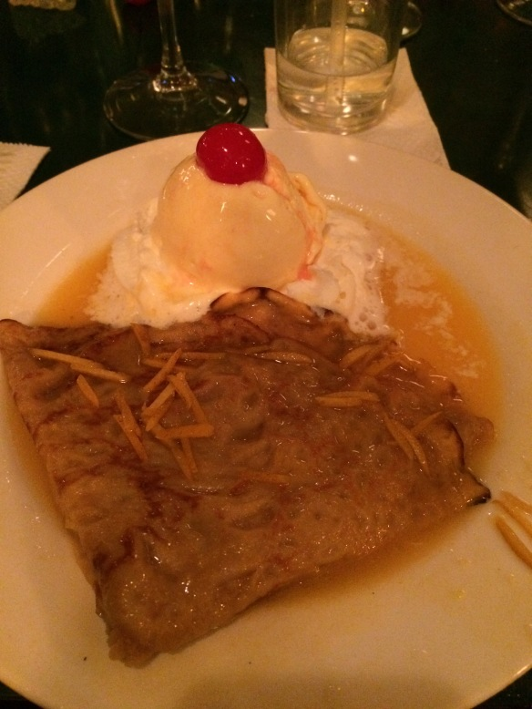 The crepe suzette with flaming grand marnier over and vanilla ice cream for dessert.